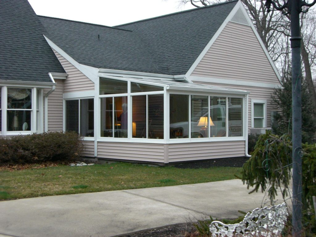 Sunrooms solid roof glass roof four season more for Sunroom roofs