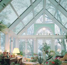 Glass cathedral sunroom decorated with plants