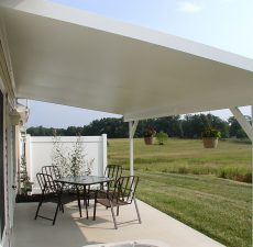 side view of white outdoor patio cover installation