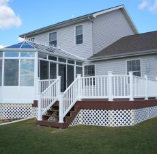 Conservatory style sunroom with sliding doors to a deck
