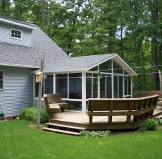 solid cathedral roof sunroom addition to deck