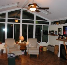 indoor view of solud roof cathedral sunroom at night