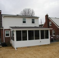 solid roof sunroom installation with straight roof