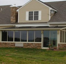 installed backyard solid roof sunroom with walkout sliding doors